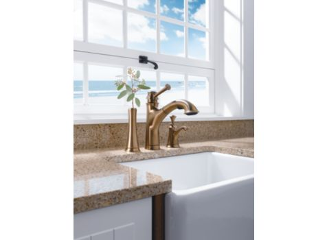 Brizo Baliza Faucet Over a Farmhouse Kitchen Sink