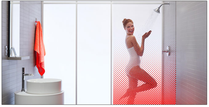 Woman Using Kohler Moxie Showerhead